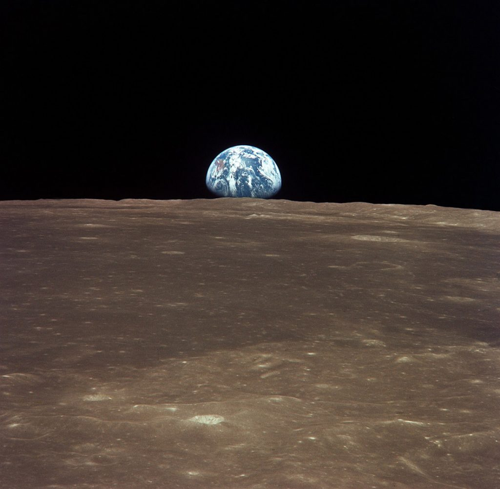 View from the Apollo 11 shows Earth rising above the moonss horizon2-1024x1002